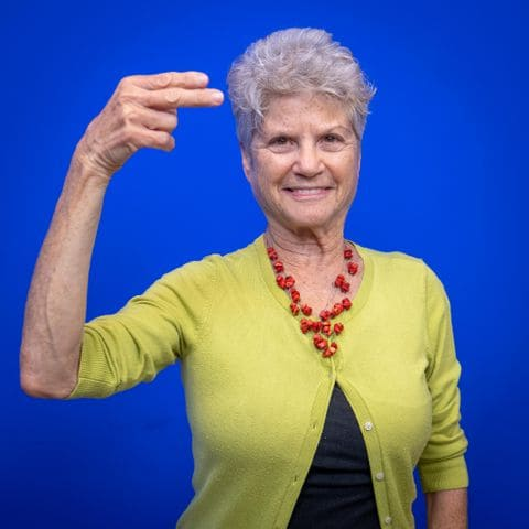 "Portrait of Janie Golighty, fingerspelling ""H"""