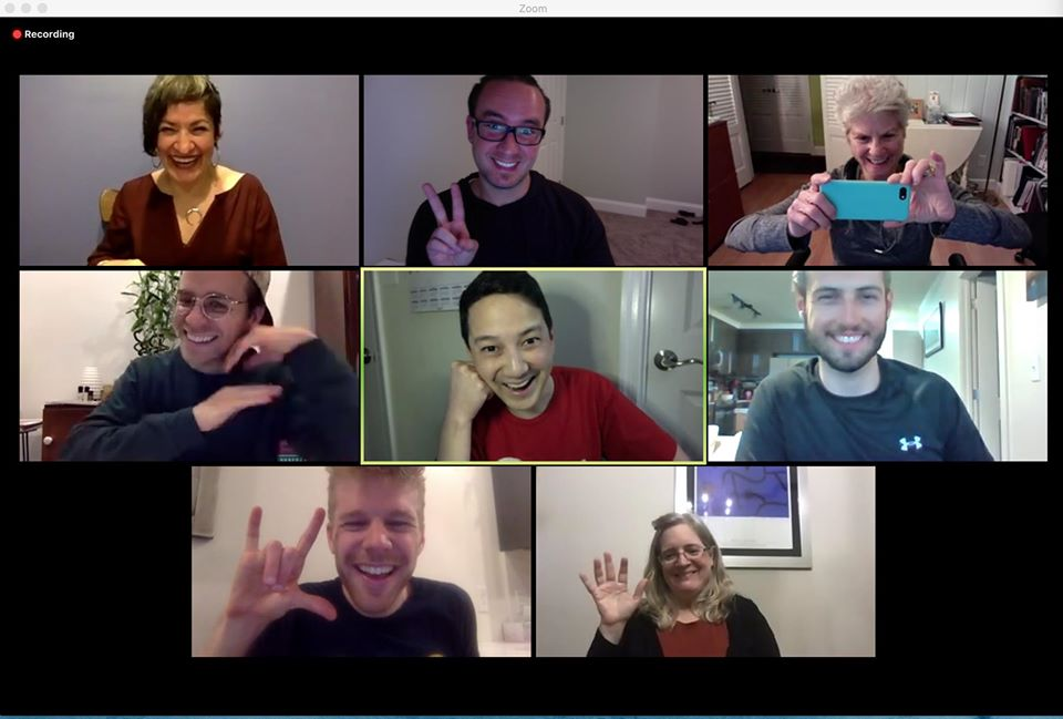 "Zoom call with eight of nine DCAD board members: Elvia, Ernest, Janie, Derrick, Erikson, Graham, Robb, and Molly are laughing, waving at the camera, signing ""ILY,"" taking photos, and smiling."